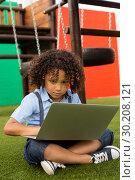 Купить «Schoolgirl using laptop in the school playground», фото № 30208121, снято 17 ноября 2018 г. (c) Wavebreak Media / Фотобанк Лори