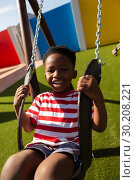 Купить «Schoolboy playing on a swing at school playground», фото № 30208221, снято 17 ноября 2018 г. (c) Wavebreak Media / Фотобанк Лори