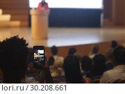Купить «Man with smartphone taking video clip of businesswoman in the auditorium », фото № 30208661, снято 15 ноября 2018 г. (c) Wavebreak Media / Фотобанк Лори
