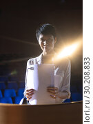 Купить «Businesswoman standing at podium on stage in auditorium», фото № 30208833, снято 15 ноября 2018 г. (c) Wavebreak Media / Фотобанк Лори