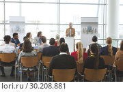 Купить «Female speaker speaks in a business seminar», фото № 30208881, снято 21 ноября 2018 г. (c) Wavebreak Media / Фотобанк Лори