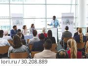 Купить «Male speaker speaks in a business seminar», фото № 30208889, снято 21 ноября 2018 г. (c) Wavebreak Media / Фотобанк Лори