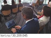 Купить «Businessman using laptop during business seminar», фото № 30209045, снято 21 ноября 2018 г. (c) Wavebreak Media / Фотобанк Лори