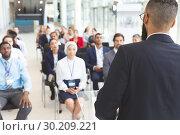Купить «Male speaker speaks in a business seminar», фото № 30209221, снято 21 ноября 2018 г. (c) Wavebreak Media / Фотобанк Лори