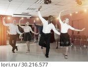 Купить «Couples enjoying tap dance», фото № 30216577, снято 4 октября 2018 г. (c) Яков Филимонов / Фотобанк Лори