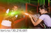 Купить «Positive guy holding laser guns and took aim during laser tag ga», фото № 30216681, снято 23 августа 2018 г. (c) Яков Филимонов / Фотобанк Лори