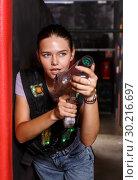 Купить «Positive girl took aim during laser tag game», фото № 30216697, снято 23 августа 2018 г. (c) Яков Филимонов / Фотобанк Лори