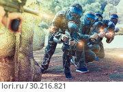 Купить «Paintball players aiming with gun», фото № 30216821, снято 22 сентября 2018 г. (c) Яков Филимонов / Фотобанк Лори