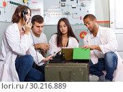 Купить «Young people in lost room-bunker», фото № 30216889, снято 8 октября 2018 г. (c) Яков Филимонов / Фотобанк Лори