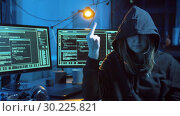 Купить «female hacker showing middle finger in dark room», видеоролик № 30225821, снято 27 февраля 2019 г. (c) Syda Productions / Фотобанк Лори