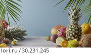 Купить «Various juicy exotic fruits - lychee, pineapple and carambola on a gray wooden table on a blue. Dolly out motion, 4K UHD video, 3840, 2160p.», видеоролик № 30231245, снято 4 июля 2018 г. (c) Ярослав Данильченко / Фотобанк Лори