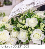 Купить «Wedding decor and accessory. Beautiful bouquet of white roses for the bride», фото № 30231505, снято 27 февраля 2019 г. (c) Светлана Евграфова / Фотобанк Лори