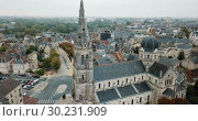 Купить «Aerial view of picturesque Chateauroux cityscape with Catholic Church of Our Lady, central France», видеоролик № 30231909, снято 25 октября 2018 г. (c) Яков Филимонов / Фотобанк Лори