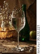 Glass with white wine on a wooden table. Стоковое фото, фотограф Марина Володько / Фотобанк Лори