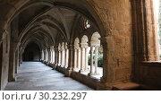 Купить «Architecture of cloister in courtyard of Monastery of Santa Maria de Vallbona, Urgell, Catalonia, Spain», видеоролик № 30232297, снято 11 февраля 2019 г. (c) Яков Филимонов / Фотобанк Лори