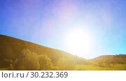 Купить «4K UHD mountain meadow timelapse at the summer. Clouds, trees, green grass and sun rays movement.», видеоролик № 30232369, снято 1 мая 2018 г. (c) Александр Маркин / Фотобанк Лори