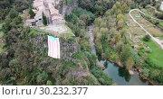 Купить «Picturesque landscape with medieval village of Castellfollit de la Roca on rocky cliff, Spain», видеоролик № 30232377, снято 4 ноября 2018 г. (c) Яков Филимонов / Фотобанк Лори
