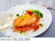 Купить «Steak of fried salmon with smoked carrots, broccoli, cucumbers and fig on plate», фото № 30233389, снято 14 октября 2019 г. (c) Яков Филимонов / Фотобанк Лори