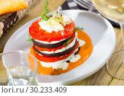 Купить «Fried eggplant pyramid with tomatoes on spicy sauce», фото № 30233409, снято 26 марта 2019 г. (c) Яков Филимонов / Фотобанк Лори