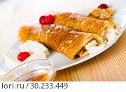 Купить «Bulgarian crepes Palatschinke on white dish», фото № 30233449, снято 19 сентября 2019 г. (c) Яков Филимонов / Фотобанк Лори