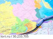 Купить «Игрушечная модель пассажирского поезда, идущего по Транссибирской магистрали», фото № 30233705, снято 3 марта 2019 г. (c) Oles Kolodyazhnyy / Фотобанк Лори