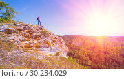 Купить «A tourist stands on top of a mountain and admires from above a view of the Ural taiga. Bashkortostan.», фото № 30234029, снято 1 сентября 2018 г. (c) Акиньшин Владимир / Фотобанк Лори