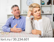 Купить «Husband and wife arguing with each other and try to resolve family conflict at table», фото № 30234601, снято 26 марта 2019 г. (c) Яков Филимонов / Фотобанк Лори