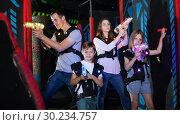 Купить «Kids with parents during lasertag game», фото № 30234757, снято 6 июня 2018 г. (c) Яков Филимонов / Фотобанк Лори