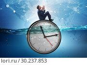 Купить «Businessman in deadline and time management concept», фото № 30237853, снято 19 марта 2019 г. (c) Elnur / Фотобанк Лори