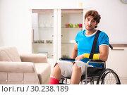 Купить «Injured man recovering from his injury», фото № 30238189, снято 21 сентября 2018 г. (c) Elnur / Фотобанк Лори