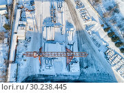 Купить «Open warehouse for storage of large diameter metal pipes. A gantry crane is installed in the territory. Winter sunny day.», фото № 30238445, снято 23 января 2019 г. (c) Андрей Радченко / Фотобанк Лори