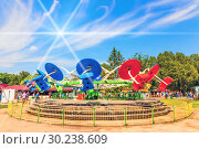 Купить «Russia, Samara, May 2016: young girls ride on the carousel in the city park named after Gagarin against the blue sky on a sunny day.», фото № 30238609, снято 28 мая 2016 г. (c) Акиньшин Владимир / Фотобанк Лори