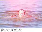 The girl drowned and the water hit her nose when she bathed. Стоковое фото, фотограф Акиньшин Владимир / Фотобанк Лори