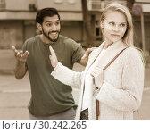 Купить «Couple is quarrelling because of the disagreements between them», фото № 30242265, снято 10 августа 2017 г. (c) Яков Филимонов / Фотобанк Лори