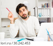 Купить «Office worker pondering work task», фото № 30242453, снято 27 июня 2019 г. (c) Яков Филимонов / Фотобанк Лори