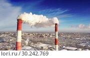 Купить «Power plant pipes on the background of the panorama of the winter city against blue sky», видеоролик № 30242769, снято 5 марта 2019 г. (c) Mikhail Starodubov / Фотобанк Лори