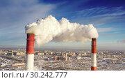Купить «Power plant pipes on the background of the panorama of the winter city against blue sky», видеоролик № 30242777, снято 5 марта 2019 г. (c) Mikhail Starodubov / Фотобанк Лори