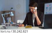 Купить «businesswoman calling on smartphone at dark office», видеоролик № 30242821, снято 28 февраля 2019 г. (c) Syda Productions / Фотобанк Лори
