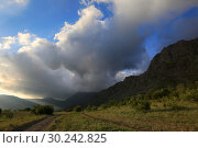 Купить «Beautiful clouds in the sky and bright colors of the summer in the Valley of the Demerdji Mountains in Crimea», фото № 30242825, снято 24 июня 2017 г. (c) Яна Королёва / Фотобанк Лори