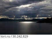 Купить «Heavenly light through thunderstorm clouds overlooking the sea and mountains off the coast of Crimea», фото № 30242829, снято 23 мая 2017 г. (c) Яна Королёва / Фотобанк Лори