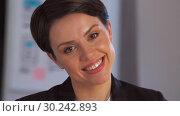 Купить «portrait of smiling businesswoman at night office», видеоролик № 30242893, снято 28 февраля 2019 г. (c) Syda Productions / Фотобанк Лори