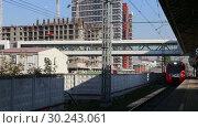 Купить «Modern high-speed train Lastochka. Little Ring of the Moscow Railways- MCC,or MK MZD, is a 54.4-kilometre-long orbital railway. Russia», видеоролик № 30243061, снято 3 марта 2019 г. (c) Владимир Журавлев / Фотобанк Лори
