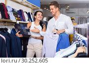 Купить «Couple purchasing shirt, tie and jacket at boutique», фото № 30252605, снято 24 октября 2016 г. (c) Яков Филимонов / Фотобанк Лори
