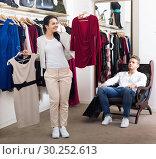 Купить «Family choosing dress and blouse at clothing shop», фото № 30252613, снято 24 октября 2016 г. (c) Яков Филимонов / Фотобанк Лори