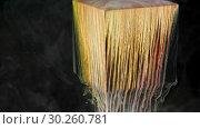 Купить «Multicolored ink paint slowly flows from the cube underwater», видеоролик № 30260781, снято 24 июля 2019 г. (c) Dzmitry Astapkovich / Фотобанк Лори