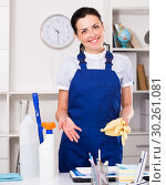 Купить «Young and smiling woman cleaning room», фото № 30261081, снято 2 июня 2017 г. (c) Яков Филимонов / Фотобанк Лори