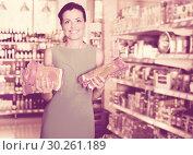 Купить «Woman choosing pack of spaghetti», фото № 30261189, снято 6 июня 2017 г. (c) Яков Филимонов / Фотобанк Лори