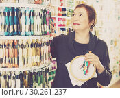Купить «Woman choosing mouline for embroidery in needlework shop», фото № 30261237, снято 10 мая 2017 г. (c) Яков Филимонов / Фотобанк Лори
