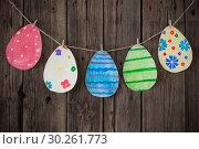 Купить «Paper Easter painted eggs painted hang on clothespins on background old wooden wall.», фото № 30261773, снято 6 марта 2019 г. (c) Майя Крученкова / Фотобанк Лори