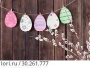 Купить «Easter painted paper eggs with branches willow», фото № 30261777, снято 6 марта 2019 г. (c) Майя Крученкова / Фотобанк Лори